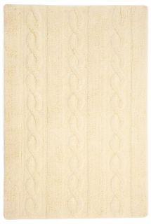 Rectangular yellow cream rug with raised braided stripe design