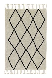 Rectangular beige cotton rug decorated with a black geometric tribal design and braided border