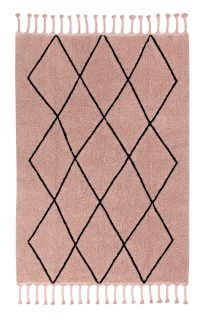 Rectangular nude pink cotton rug decorated with a black geometric tribal design and braided border