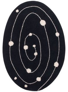 Oval-shaped black cotton rug decorated with an abstract circular design and white circles.