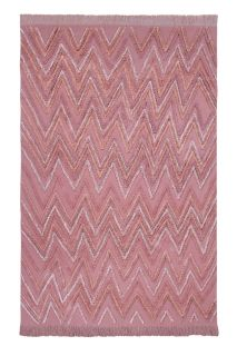 Rectangular pink rug decorated with raised woven geometric zig-zag design in pink yarn