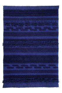 Rectangular blue rug decorated with a raised textured stripe pattern