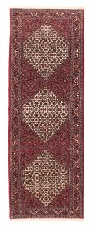Red Persian wool rug with traditional design