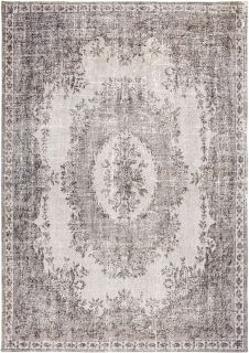 white vintage style rug with a traditional design