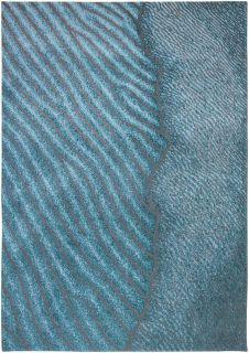 blue rug with an abstract wave design