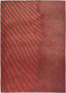 red rug with an abstract wave design
