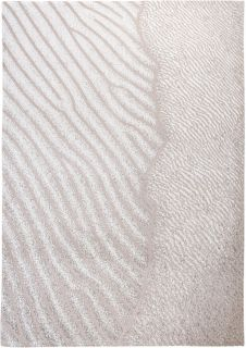 beige rug with an abstract wave design