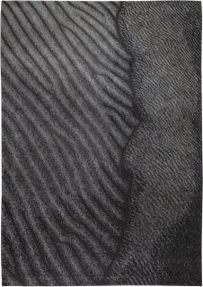 grey rug with an abstract wave design