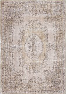 beige vintage style rug with a traditional design