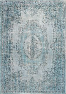 blue vintage style rug with a traditional design