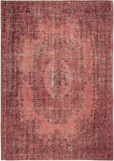 red vintage style rug with a traditional design