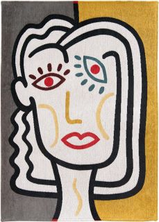 yellow, blue and red rug with an abstract face
