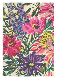 Rectangular white wool rug with pink, yellow, purple and green flowers and leaves