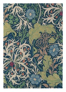 Grey wool rug with traditional floral and foliage pattern