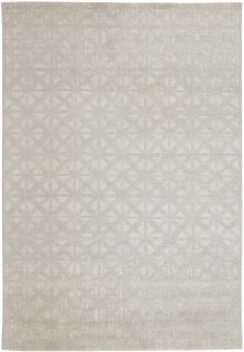 area rug with a geometric design in grey