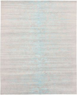 Large area rug with abstract design in beige and blue