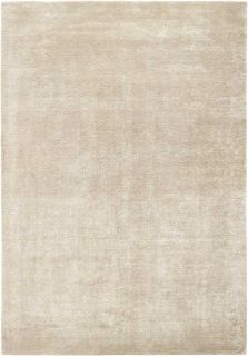 Large plain beige rug