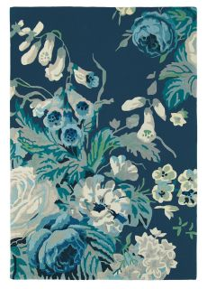 Rectangular dark blue rug with floral rose and leaf illustrations in blue and grey
