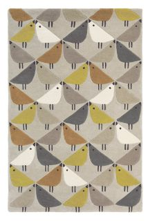 Beige rectangular rug decorated with a repeating bird pattern in brown, green, taupe and white