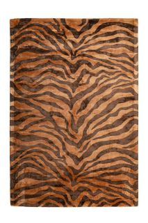 brown area rug with animal print