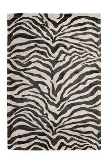 black and white area rug with animal print