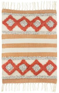 moroccan style geometric rug in orange and white