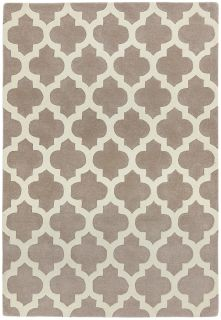 beige rug with a geometric ogee pattern