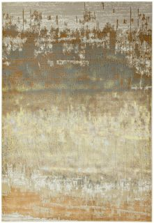 beige and brown abstract rug with a marble design