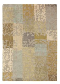 beige brink and campman wool rug with a traditional patchwork design