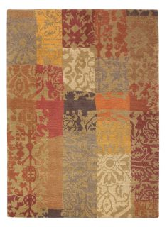 red and yellow brink and campman wool rug with a traditional patchwork design