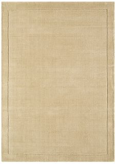 A plain beige rectangle-shaped wool rug with thin border.