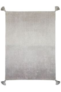 An ombre grey and green rectangular cotton rug. Large tassel on each corner.