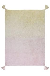 An ombre vanilla cream and pastel pink rectangular cotton rug. Large tassel on each corner.