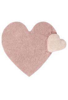A large pink cotton rug shaped like a heart, with a smaller detachable nude heart cushion