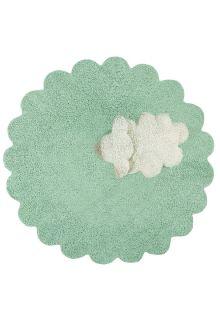Circular green cotton rug with scalloped edge and detachable cream sheep cushion