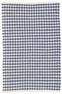 woven cotton rug with blue check pattern