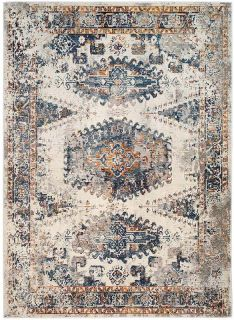 aztec style area rug in blue, ceam and rust