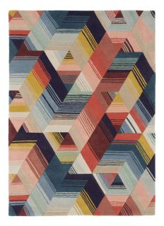 Harlequin rug with a multi-directional stripe design in red, blue and yellow
