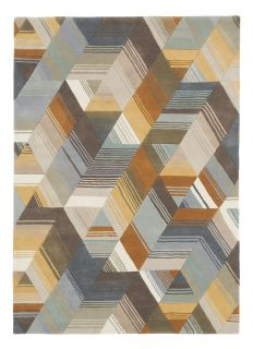 Harlequin rug with a multi-directional stripe design in grey and mustard yellow