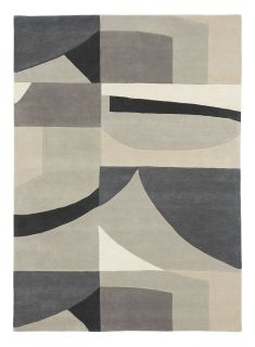 Harlequin rug with a grey abstract-geometric pattern