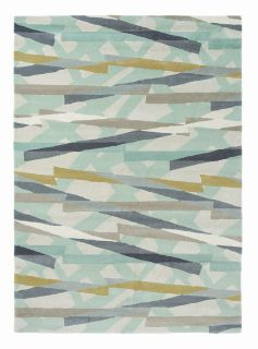 mint green wool rug with abstract design in mustard, grey and taupe