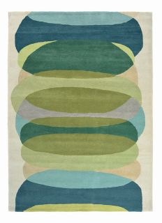 green wool rug with astract design