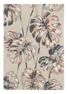 Harlequin rug with a pink and beige leaf pattern