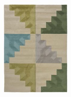 geometric wool rug with green, blue and cream design