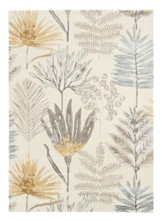 Harlequin rug with a cream and yellow floral pattern