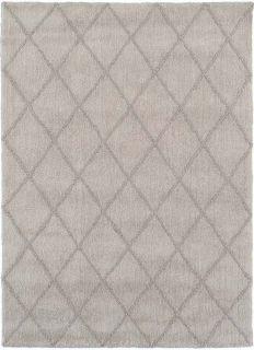 cream area rug with subtle diamond design