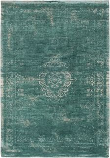 green flatweave rug with faded persian design