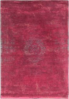 Red rug with faded persian design