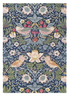 Wool rug with floral bird design in blue, red and green