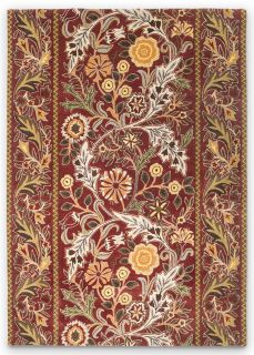 red wool rug with multicolour floral design